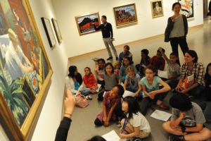 A school group at the Metropolitan Museum of Art. A google image search for school museum visits reveals myriad pictures of scenes just like this one.