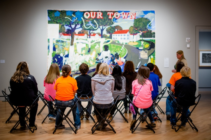 "Students in front of Kerry Marshall's painting ""Our Town"" at the Crystal Bridges Museum of American Art"
