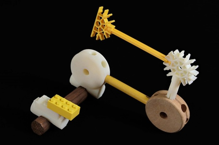 The Free Universal Construction Kit from Free Art and Technology Lab, which allow you to combine  Lego, K'Nex, Bristle Blocks, Tinkertoys, and more.